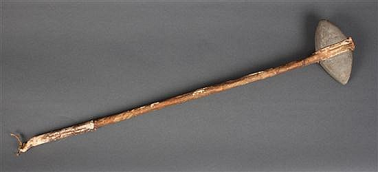 Native American stone, wood, and rawhide club, south western United States, late 19th century, 28 1/2 in. L.