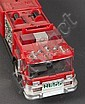Hess fire pumper truck with original box, and a Hess fire engine ladder truck