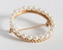 Lady's 14K gold and pearl circle brooch