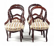 Four Victorian walnut balloon-back chairs