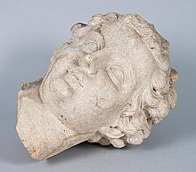 Continental carved limestone head fragment