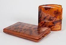 Two tortoiseshell cases