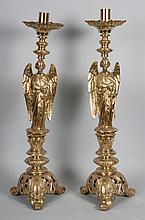 Pair of brass ecclesiastical figural candlesticks