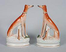 Pair of Staffordshire whippet figures