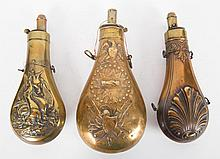 Two brass and copper and one brass powder horn