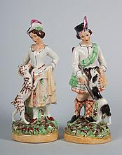 Pair of Staffordshire lad and lassie figures