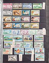 Four stockbooks: worldwide postage stamps