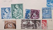 Four stockbooks, worldwide postage stamps