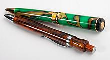 Two Romet roller ball pens