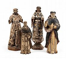 Four carved and polychromed wood Santos figures