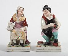 Pair of Staffordshire earthenware figures