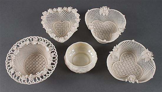Four Belleek glazed parianware baskets, and similar sugar bowl