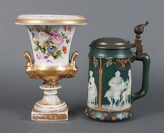 Mettlach pewter-mounted salt glazed stoneware stein of half liter capacity, and a Porcelain de Paris floral and gilt decorated urn