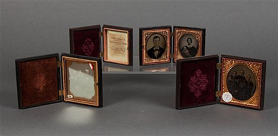 [Photography] Four thermoplastic Union cases, most with daguerreotypes or ambrotypes, mid 19th century