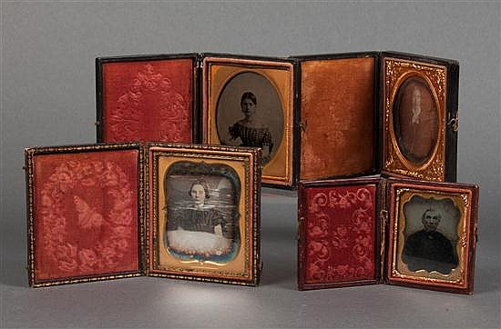 [Photography] Two daguerreotypes and two ambrotypes in stamped leather and cloth cases