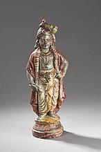 Krishna debout richement vêtu et paré.