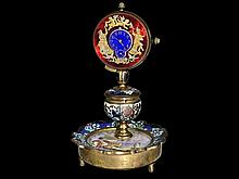 decorative enamel table clock with pocket watch movement, repetition and figured automaton, ca. 1900