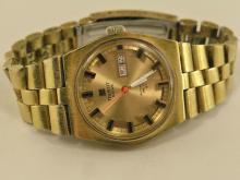 Armbanduhr: automatische Herrenuhr mit Tag und Datum,Tissot PR 516 GL, 70er Jahre