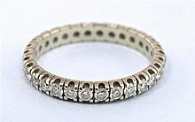 White fold eternity ring with diamonds