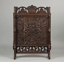 A Pair of Carved Oak Gothic Fire Screens