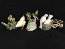 Set of vintage porcelain figures including a music box and light