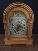 Antique Oak Ansonia Clock Co. mantle clock with brass detail - good cond
