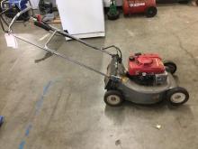 A Honda HR215 self propelled lawnmower. Runs great