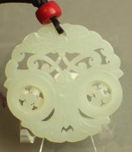 A White Jade Pendant Carved in Two Eyes