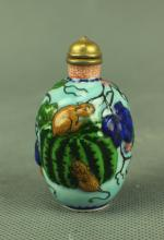A Porcelain Snuff Bottle Carved in Mouse & Melon Marked Qian Long, Qing