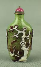 A Green Glass Snuffbottle Carved in Birds and Flowers, Qing