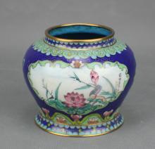 A CLOISONNE JAR IN FLOWER AND BIRD PATTERN