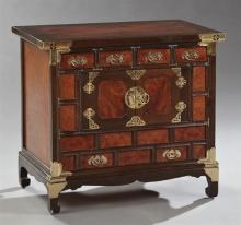 Korean Brass Bound Burled Walnut and Mahogany Altar Cabinet, 20th c., the inlaid top over four short drawers above two cupboard door...