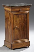 French Louis Philippe Carved Mahogany Marble Top Nightstand, 19th c., the rectangular dished highly figured black marble over a cave...