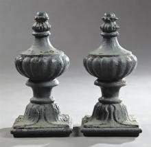 Pair of Late Victorian Cast Iron Fence Post Finials, c. 1900, the tapered ball top to a lobed urn on a tapered circular socle, to a...