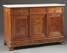 French Louis Philippe Carved Walnut Marble Top Sideboard, 19th c., the highly figured canted corner white marble over three drawers,...