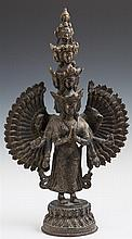 Indian Bronze Figure of Shiva, early 20th c., with multiple heads and arms, H.- 15 in., W.- 9 in., D.- 4 in.
