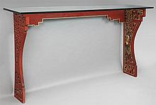 Chinese Qing Style Parcel Gilt Red Lacquered Console, 20th c., with a plate glass top on a pierced carved figural and foliate base,...