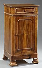 French Louis Philippe Carved Rosewood Nightstand, 19th c., the canted corner top over a frieze drawer, above a cupboard door on a pl...