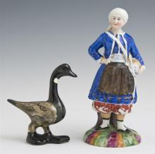 Two Polychromed Glazed Soft Paste Porcelain Figures, 19th c., of a goose and a woman standing before a tree stump, Woman- H.- 6 1/2...