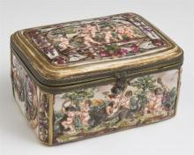 †Capodimonte Brass Mounted Porcelain Dresser Box, early 20th c., with relief figures of frolicking putti, H.- 3 1/8 in., W.- 5 7/8 in..