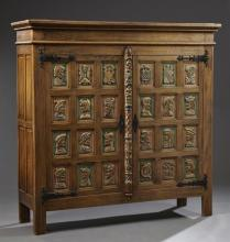 Spanish Colonial Style Polychromed Oak Cabinet, 20th c., the stepped crown over two paneled doors, each panel with a relief profile...