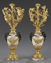 Pair of French Gilt and Patinated Bronze and Violette Marble Five Light Candelabra, late 19th c., the floriform candle arms mounted...