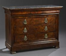 French Restoration Style Carved Walnut Marble Top Commode, 19th c., the rectangular highly figured grey marble over a cavetto carved...