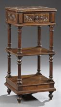 French Henri II Style Carved Oak Marble Top Nightstand, 19th c., the inset highly figured rouge marble over a frieze drawer, above a...