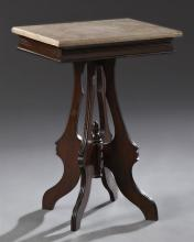 American Eastlake Carved Walnut Marble Top Lamp Table, late 19th c., the rectangular figured tan top over a wide reeded skirt on fla...