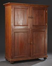 Southern American Carved Cypress Cupboard, 20th c., possibly New Orleans, the ogee crown over two cupboard doors above two lower cup...