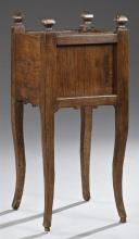 Unusual French Provincial Gothic Style Carved Oak Nightstand, 19th c., with four finials flanking a dished square top over a lifting...