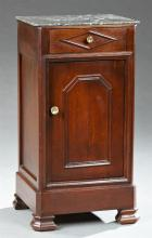 French Louis Philippe Style Carved Mahogany Marble Top Nightstand, 19th c., the highly figured square black marble over a frieze dra...