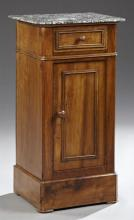 French Louis Philippe Carved Walnut Marble Top Walnut Nightstand, 19th c., the rounded corner highly figured black marble over a fri...