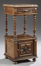 French Louis XVI Style Carved Walnut Marble Top Nightstand, late 19th c., the inset highly figured brown marble over a frieze drawer...